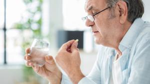 senior taking prescription opioids